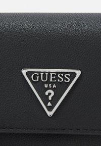 Guess - AMBROSE MINI CROSSBODY FLAP - Borsa a tracolla - black - 4