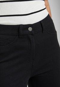 Next - BLACK FLY FASTEN JERSEY DENIM LEGGINGS - Jeans Skinny Fit - black - 2
