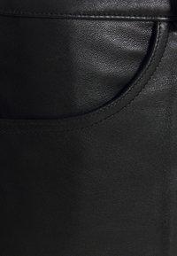 sandro - Leather trousers - noir - 2