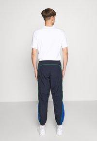 Levi's® - LEVI'S® X PEANUTS MILES TRACK PANT UNISEX - Trainingsbroek - black/blue - 2