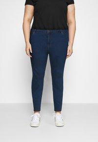 Vero Moda Curve - VMJUDY SLIM CURVE - Slim fit jeans - medium blue denim - 0