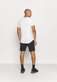 Umbro - TAPED SHORT LOOPBACK - Sports shorts - black - 2