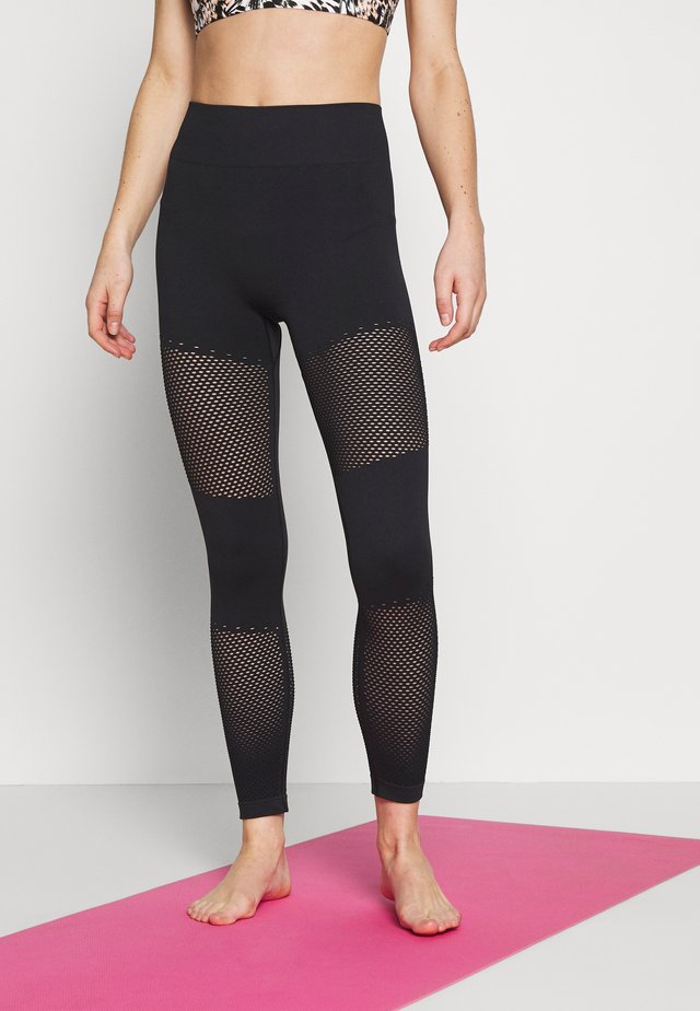 WELLNESS WARRIOR SEAMLESS LEGGING - Trikoot - black