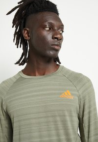 adidas Performance - RUNNER - Sports shirt - olive - 6