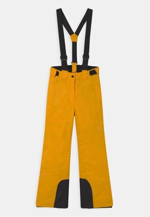 LORENA JR UNISEX - Snow pants - yellow