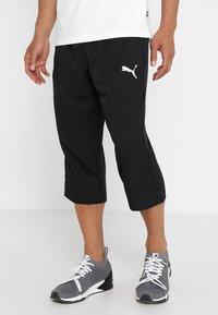 Puma - ACTIVE Pants - 3/4 sports trousers - puma black - 0
