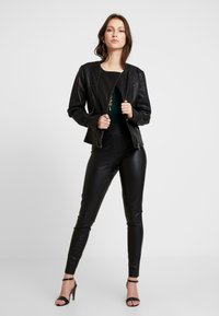 ONLY - ONLSUPER STAR - Pantalon classique - black