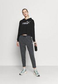 Puma - EVOSTRIPE PANTS - Pantalones deportivos - black heather - 1