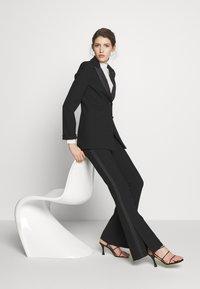 Victoria Victoria Beckham - SPLIT HEM TUXEDO TROUSER - Spodnie materiałowe - black - 4