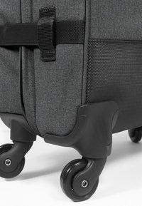 Eastpak - TRANS4 S - Valise à roulettes - black denim - 4