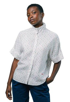 MAGIC EYES - Button-down blouse - white