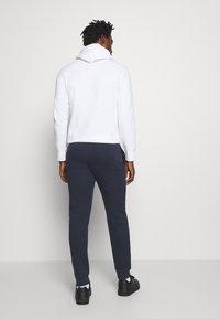 Champion - LEGACY CUFF PANTS - Teplákové kalhoty - dark blue - 2