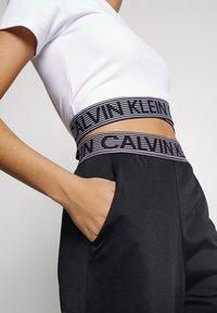 Calvin Klein Performance - PANT - Pantalon de survêtement - black - 5