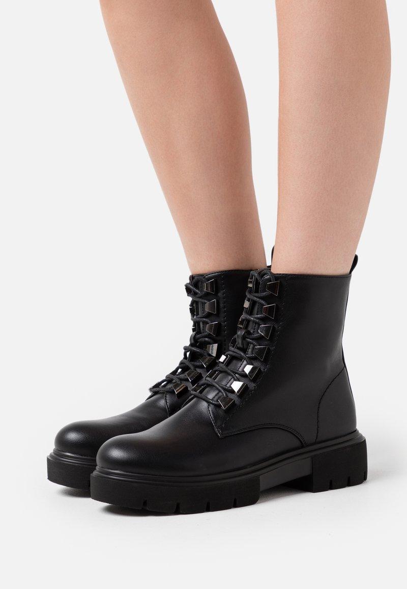 KHARISMA - Platform ankle boots - soft nero