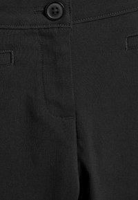 Next - Kalhoty - mottled black - 2