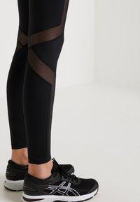 Daquïni - FLUXUS - Leggings - Trousers - black - 5