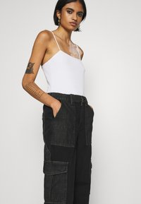 BDG Urban Outfitters - SKATE - Relaxed fit jeans - black/grey patchwork - 3