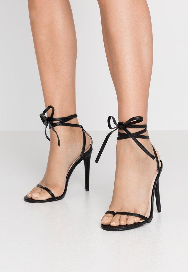 VENZA - Sandaalit nilkkaremmillä - black