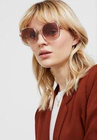 Coach - Sunglasses - shiny rose gold-coloured/pink - 1