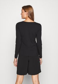Calvin Klein Jeans - V NECK - Long sleeved top - black - 2