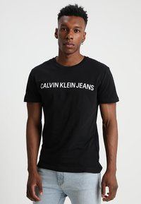 Calvin Klein Jeans - CORE INSTITUTIONAL LOGO TEE - T-shirt med print - ck black - 0