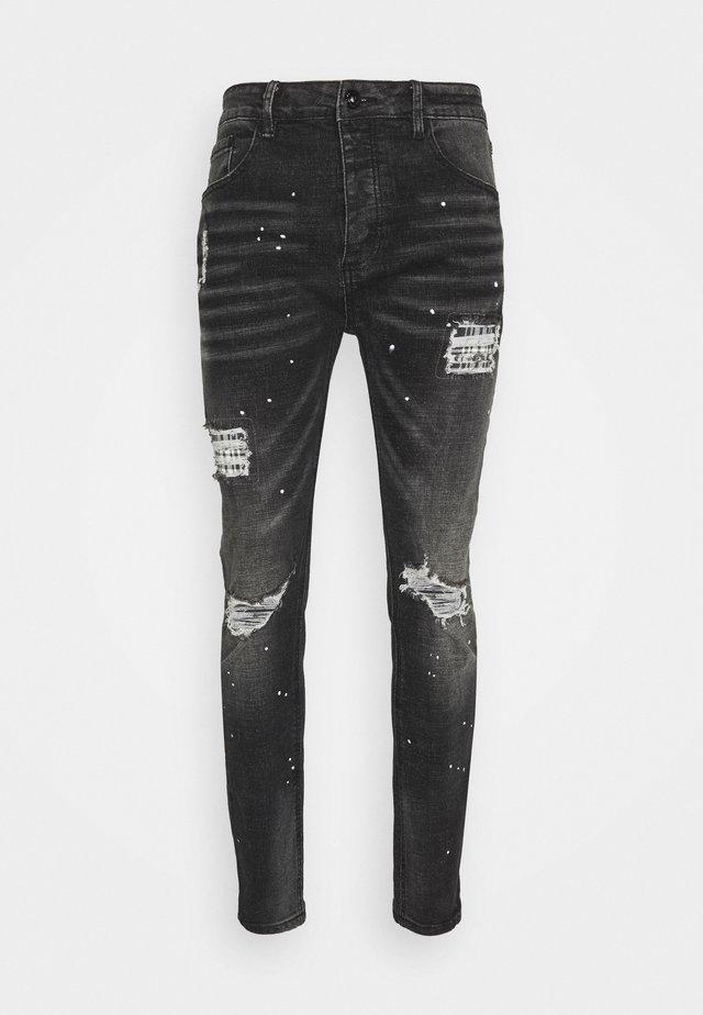 INWOOD CARROT - Slim fit jeans - jet black