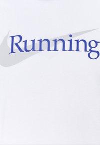 Nike Performance - TEE - Triko spotiskem - white - 6