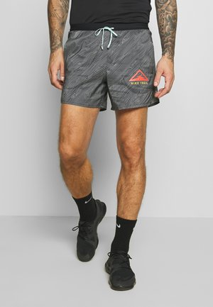STRIDE TRAIL - Sports shorts - black/laser crimson