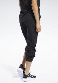 Reebok - PANT - Teplákové kalhoty - black - 2