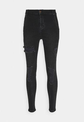 DISTRESSED SUPER  - Jeans Skinny Fit - black