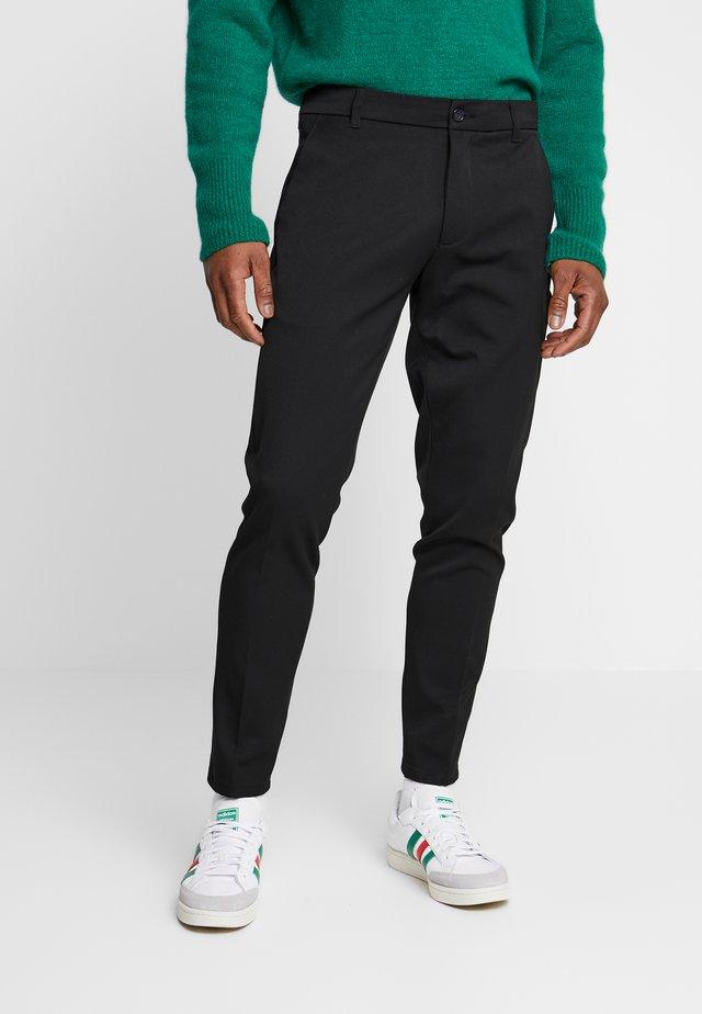 UGGE - Pantaloni - black