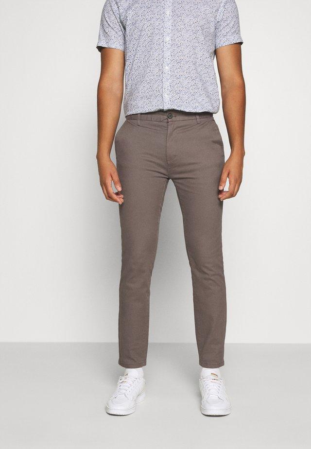 Pantalones chinos - aubergine