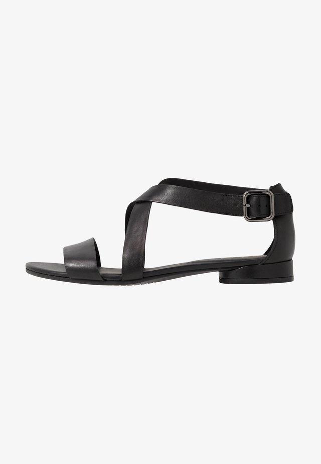 FLAT - Sandaalit nilkkaremmillä - black santiago
