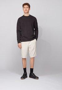 BOSS - WALKUP - Sweatshirt - black - 1