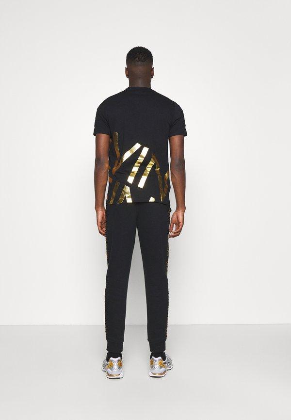 Calvin Klein GOLD LOGO SWEATPANTS - Spodnie treningowe - black/czarny Odzież Męska FAMC