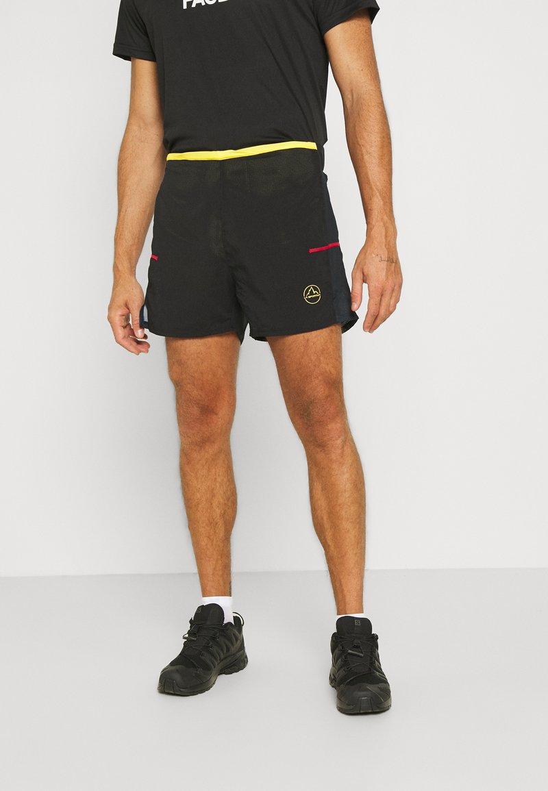 La Sportiva - FRECCIA SHORT - Sports shorts - black/yellow