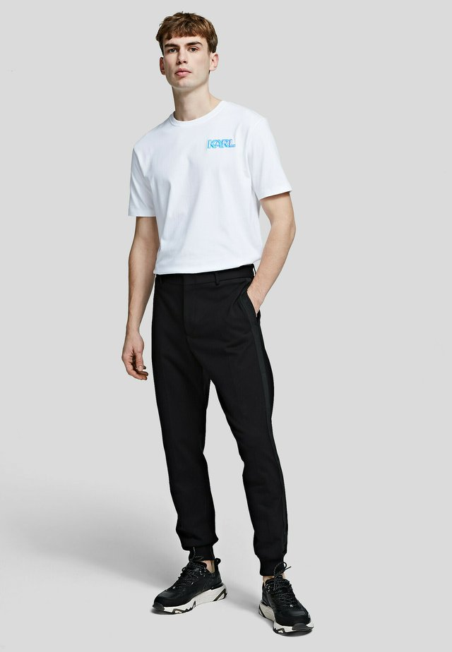 PUNTO - Chino kalhoty - black