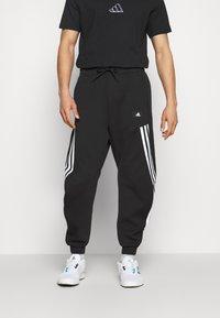 adidas Performance - 3-STRIPES O-PANT FUTURE ICONS - Tracksuit bottoms - black - 0