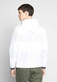 Tommy Hilfiger - LIGHT WEIGHT HOODED  - Summer jacket - white - 2