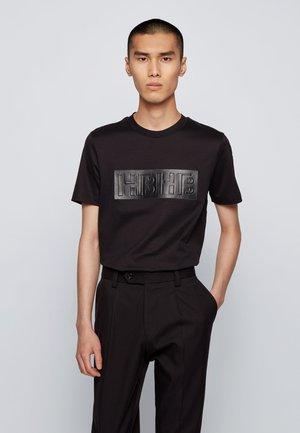 TESSLER 182 - Print T-shirt - black