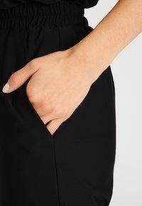 Daquïni - Trousers - black - 3