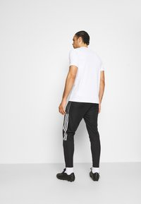 adidas Performance - TIRO 21 - Pantalon de survêtement - black - 2