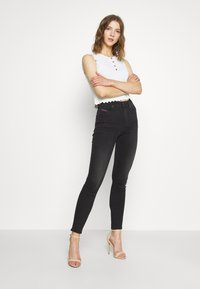 Diesel - D-ROISIN-HIGH - Jeans Skinny Fit - washed black - 1