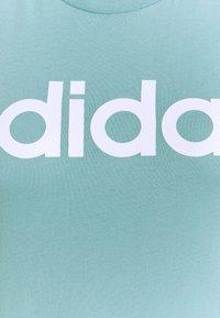adidas Performance - Triko spotiskem - mint ton/white - 6