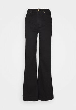 MODERN DOJO - Flared Jeans - black