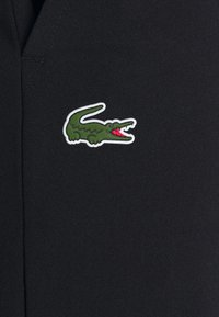 Lacoste Sport - NAMING TRACK PANT - Tracksuit bottoms - black/white - 2