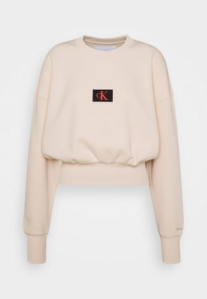 BADGE INTERLOCK - Long sleeved top - tapioca