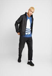 adidas Originals - GRAPHICS SPORT INSPIRED JACKET - Windbreaker - black - 1