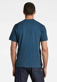 G-Star - MOTO NEOPRENE R T - T-shirt print - luna blue - 1