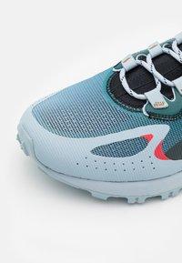 Reebok - AT CRAZE ADVENTURE - Trail running shoes - gable grey/midnight pine/black - 5